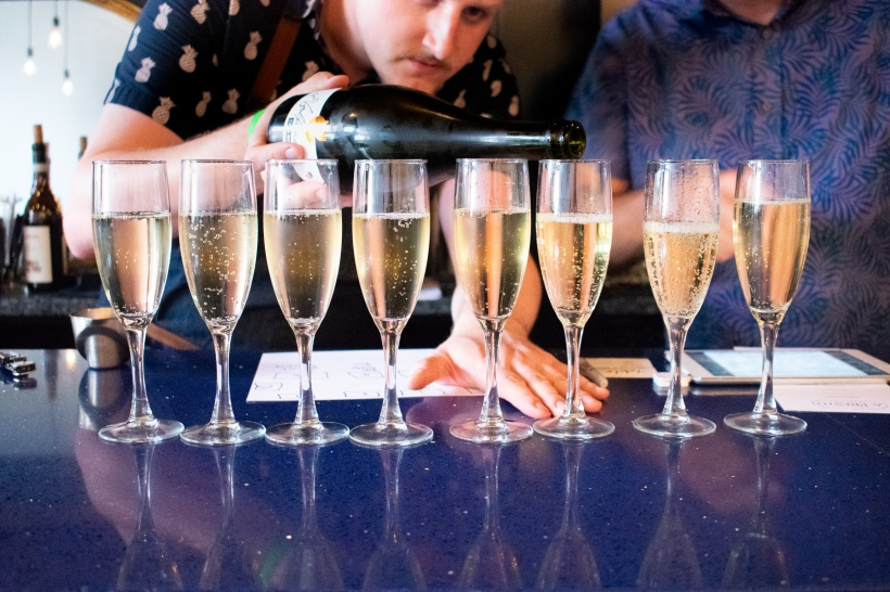 Champagne pouring at A Presto Italian Foods' Pop-up Dinner Event | Washington, DC Event Photographer